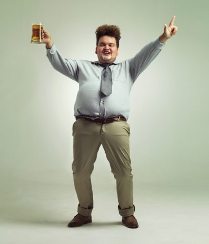 overweight man celebrating while holding a pint of beer